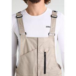 Oakley TIMBER BIB Spodnie narciarskie rye. Spodnie snowboardowe męskie marki WED'ZE. W wyprzedaży za 951.20 zł.