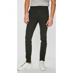 Tommy Hilfiger - Spodnie. Szare eleganckie spodnie męskie Tommy Hilfiger, z bawełny. Za 449.90 zł.