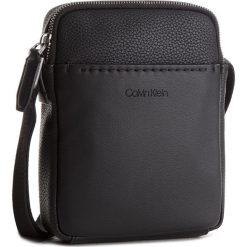 Saszetka CALVIN KLEIN - Multi Task Mini P Pre K50K503757  001. Czarne saszetki męskie Calvin Klein, ze skóry ekologicznej, młodzieżowe. Za 349.00 zł.