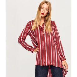 Długa koszula o satynowym połysku - Bordowy. Koszule damskie marki SOLOGNAC. W wyprzedaży za 39.99 zł.
