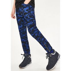 Spodnie jogger - Niebieski. Spodnie materiałowe dla chłopców marki Reserved. W wyprzedaży za 39.99 zł.