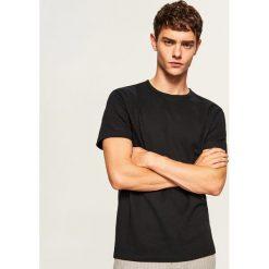 Gładki t-shirt regular fit - Czarny. T-shirty męskie marki Giacomo Conti. W wyprzedaży za 39.99 zł.