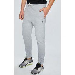Reebok - Spodnie. Szare spodnie sportowe męskie Reebok, z bawełny. W wyprzedaży za 169.90 zł.