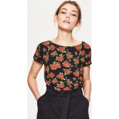 Koszulka z nadrukiem all over - Czarny. T-shirty damskie marki DOMYOS. W wyprzedaży za 19.99 zł.