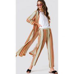 Trendyol Spodnie w paski - Multicolor. Szare spodnie materiałowe damskie Trendyol, w paski. W wyprzedaży za 56.78 zł.