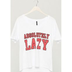 T-shirt z nadrukiem - Biały. T-shirty damskie marki DOMYOS. W wyprzedaży za 14.99 zł.