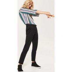Spodnie typu chino - Czarny. Spodnie materiałowe damskie marki DOMYOS. W wyprzedaży za 59.99 zł.
