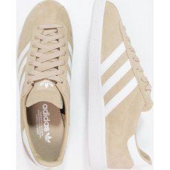 Adidas Originals MÜNCHEN Tenisówki i Trampki raw gold/footwear white/gold metallic. Trampki męskie adidas Originals, z materiału. W wyprzedaży za 404.10 zł.
