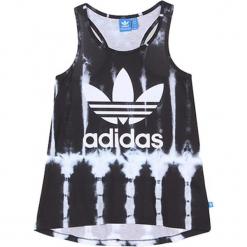 Top w kolorze czarno-białym. Białe topy damskie Adidas, Reebok, z nadrukiem, z asymetrycznym kołnierzem. W wyprzedaży za 104.95 zł.