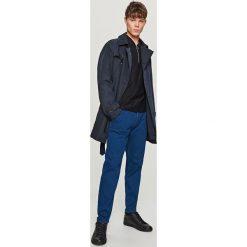 Jeansy tapered fit - Niebieski. Niebieskie jeansy męskie Reserved. Za 149.99 zł.