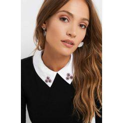 Sweter z kołnierzem. Czarne swetry damskie Orsay, z bawełny, z kontrastowym kołnierzykiem. Za 99.99 zł.