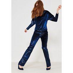 Simple - Spodnie. Szare spodnie materiałowe damskie Simple, z materiału. W wyprzedaży za 239.90 zł.