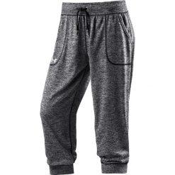 Spodnie sportowe w kolorze szarym. Szare spodnie dresowe damskie Under Armour, z materiału. W wyprzedaży za 86.95 zł.