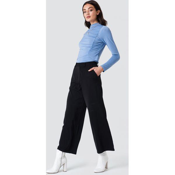 0eeb9799 NA-KD Classic Błyszczące spodnie dzwony - Black