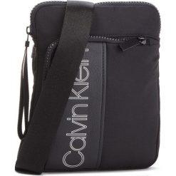 Saszetka CALVIN KLEIN - Double Logo Flat Cro K50K503900  001. Saszetki męskie marki BABOLAT. W wyprzedaży za 249.00 zł.