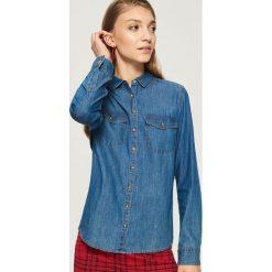 Jeansowa koszula - Niebieski. Koszule damskie marki SOLOGNAC. W wyprzedaży za 29.99 zł.