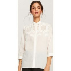 Koszula z ażurową ozdobą - Biały. Koszule damskie marki SOLOGNAC. Za 89.99 zł.