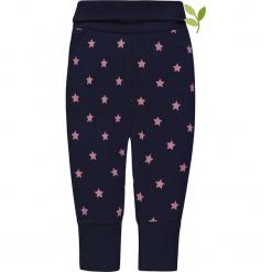 Legginsy w kolorze granatowo-jasnoróżowym. Czerwone legginsy dla dziewczynek bellybutton, z aplikacjami, z bawełny. W wyprzedaży za 37.95 zł.