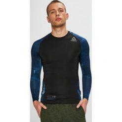 Reebok - Longsleeve. Czarne bluzki z długim rękawem męskie Reebok, z nadrukiem, z dzianiny, z okrągłym kołnierzem. W wyprzedaży za 199.90 zł.