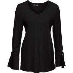 Sweter dzianinowy z rozkloszowanymi rękawami bonprix czarny. Swetry damskie marki KALENJI. Za 79.99 zł.