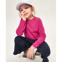 Bawełniany sweter z kokardkami na plecach - Różowy. Swetry dla dziewczynek Reserved, z bawełny, z dekoltem na plecach. W wyprzedaży za 29.99 zł.