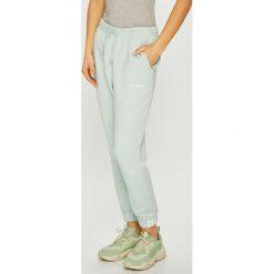 Adidas Originals - Spodnie. Szare spodnie materiałowe damskie adidas Originals, z bawełny. Za 279.90 zł.