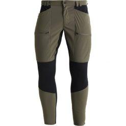 Peak Performance TRACK  Spodnie materiałowe terrain green. Spodnie materiałowe męskie Peak Performance, z elastanu, sportowe. Za 799.00 zł.