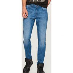 Jeansy regular fit - Niebieski. Niebieskie jeansy męskie Reserved. Za 99.99 zł.
