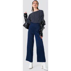 Rut&Circle Szerokie spodnie Petra - Blue,Navy. Niebieskie spodnie materiałowe damskie Rut&Circle, z poliesteru. Za 161.95 zł.