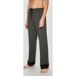Dkny - Spodnie piżamowe. Szare piżamy damskie DKNY, z dzianiny. W wyprzedaży za 239.90 zł.