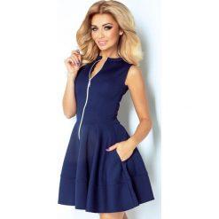 123-2 sukienka z ekspresem z przodu i kieszonkami - granat. Szare sukienki damskie NUMOCO, z długim rękawem. Za 139.00 zł.