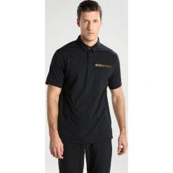 Under Armour PERPETUAL POLO Koszulka polo black. Koszulki polo męskie Under Armour, z elastanu. Za 419.00 zł.