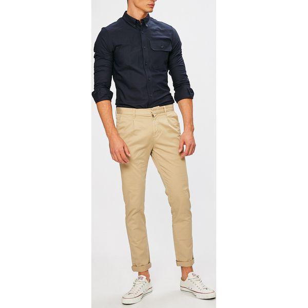 9b04492c872a8 Calvin Klein Jeans - Spodnie - Eleganckie spodnie męskie marki Calvin Klein  Jeans. W wyprzedaży za 269.90 zł. - Eleganckie spodnie męskie - Spodnie  męskie ...