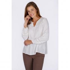 """Tunika """"Babouche"""" w kolorze kremowym. Białe tuniki damskie Scottage, w koronkowe wzory, z koronki, klasyczne. W wyprzedaży za 81.95 zł."""