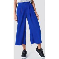Trendyol Szerokie spodnie rybaczki - Blue. Niebieskie spodnie materiałowe damskie Trendyol, z tkaniny. W wyprzedaży za 70.67 zł.