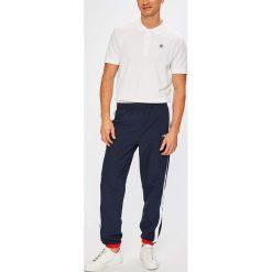 Fila - Spodnie Keenan Straight Leg. Szare spodnie sportowe męskie Fila, z materiału. W wyprzedaży za 239.90 zł.