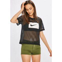 Nike Sportswear - Top. Szare topy damskie Nike Sportswear, z nadrukiem, z poliesteru, z okrągłym kołnierzem, z krótkim rękawem. Za 119.90 zł.