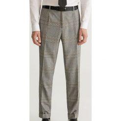 Spodnie garniturowe w kratę super slim fit - Jasny szar. Eleganckie spodnie męskie marki Giacomo Conti. W wyprzedaży za 119.99 zł.