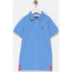 Koszulka polo w kolorze niebieskim. Koszulki polo męskie marki Reserved. W wyprzedaży za 99.95 zł.
