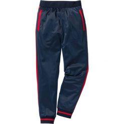 Spodnie sportowe trykotowe bonprix ciemnoniebieski. Spodnie sportowe męskie marki bonprix. Za 54.99 zł.