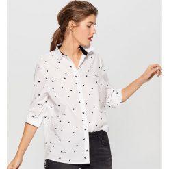Bawełniana koszula Mickey Mouse Special Collection - Biały. Białe koszule damskie Mohito, z motywem z bajki, z bawełny. Za 89.99 zł.