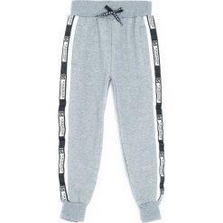 Jasnoszare Spodnie Dresowe Heated. Szare spodnie sportowe dla chłopców Born2be, z dresówki. Za 59.99 zł.