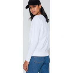 Levi's Luźna bluza Graphic Crew - White. Białe bluzy damskie Levi's. Za 242.95 zł.