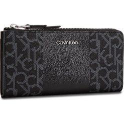 Duży Portfel Damski CALVIN KLEIN - Mono Block Large Zip K60K604693 904. Czarne portfele damskie Calvin Klein, ze skóry ekologicznej. Za 299.00 zł.