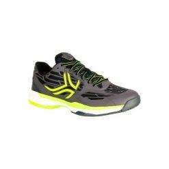 Buty tenisowe TS990 męskie na mączkę ceglaną. Niebieskie buty sportowe męskie ARTENGO, z gumy. Za 199.99 zł.