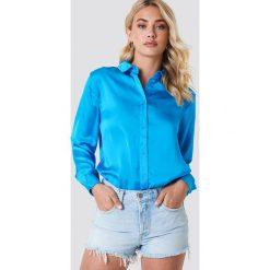 NA-KD Satynowa koszula z długim rękawem - Blue. Niebieskie koszule damskie NA-KD, z satyny, z długim rękawem. Za 133.95 zł.