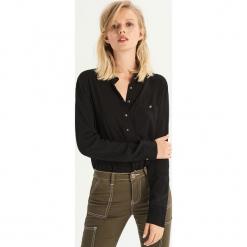 Gładka koszula z kieszenią - Czarny. Czarne koszule damskie Sinsay. Za 49.99 zł.