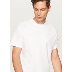 Gładki t-shirt - Biały. T-shirty damskie marki Giacomo Conti. Za 49.99 zł.