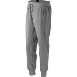 New Balance WP53502AG. Spodnie dresowe damskie New Balance, z bawełny. W wyprzedaży za 99.99 zł.