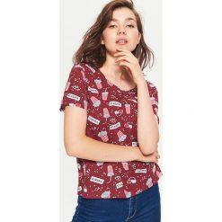 Koszulka z nadrukiem all over - Bordowy. T-shirty damskie marki DOMYOS. W wyprzedaży za 14.99 zł.